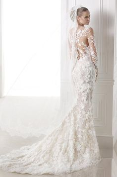 Romantic mermaid wedding dress with detachable tulle and lace skirt with gemstone embroidery. Atelier Pronovias, 2015