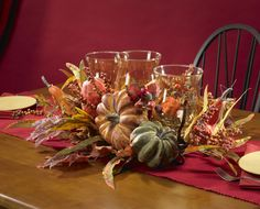 This Harvest Triple Candelabrum silk plant features an array of Autumn plants. Would be great for Thanksgiving.