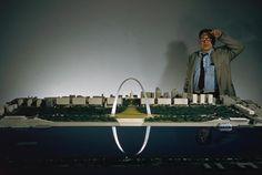 Eero Saarinen standing behind the model of the Saint Louis Gateway arch between the years of 1947-1961