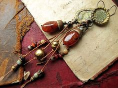 pass and cease - archaic shoulder length earrings. $44.00, via Etsy.