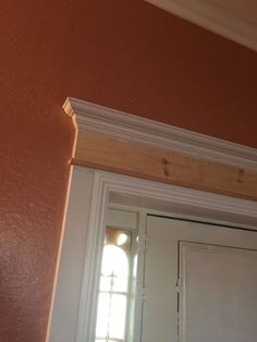 How to Make Your Front Door Look High-End -  side trim, header trim and crown moulding added. Caulk, and paint.
