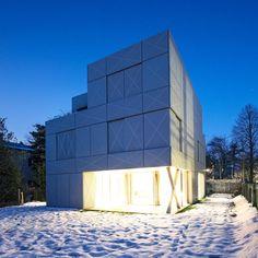 the Villa Criss-Cross Envelope was designed by OFIS arhitekti is a minimalist, cube like structure