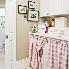 A pretty plaid curtain hides the washer and dryer in this upstairs laundry room. The homeowner hung a standard spring rod just below the counter and picked a fabric that coordinated with the adjoining spaces. Family photographs or children's artwork also instantly add personality to a workspace.