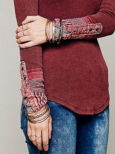 Free people; Fitted thermal top with detailed cuff and slit at front of neckline. Cuff is embellished with embroidery, striped fabric and crochet detailing.