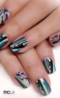 Party on in this brilliant abalone shell print nail wrap featuring subtle…