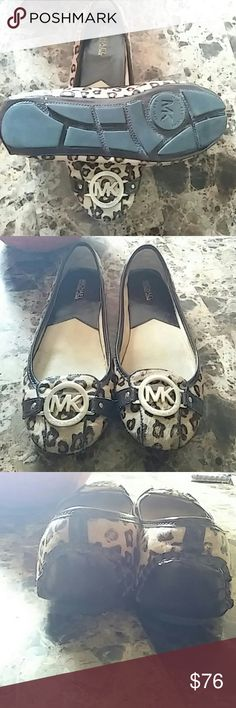 Michael kors flats Cheatah print calf hair authentic michael korrs worn a couple times in office on carpet..Good condition. *Halloween only*  Reduced $5. Michael Kors Shoes Flats & Loafers