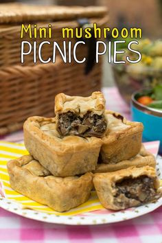 Mini mushroom picnic pies! Creamy, garlicky mushrooms wrapped in crispy pastry - heaven! Perfect for a vegetarian picnic.