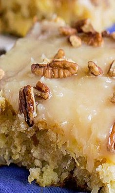 Pineapple Sheet Cake - flavored & moistened with crushed pineapple & topped with a sweet icing laced with shredded coconut, & sprinkled with pecans!