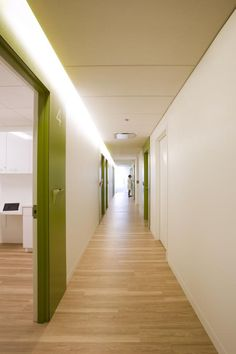 By combining wider dimensions, natural light, integrated workstations, and a more residential lighting scheme, the corridor is as welcoming as the waiting room while still being one of the most functional spaces in the suite. Photo: Andy Tinucci