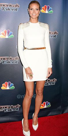HEIDI KLUM Coordinating her LWD with her stacked white pumps and her chain-draped shoulder embellishments with her gold belt, Heidi makes an appearance at an America's Got Talent event in N.Y.C.