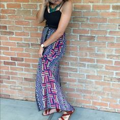 Maxi Dress This is a really fun maxi dress with a pop of colorful patterns and sweetheart shaped top. Throw a cardigan on over it and it can be worn to work. Or put some heels on and wear it to dinner. Dresses Maxi