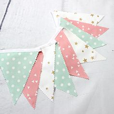 Mint green dots, blush pink and gold star make up this adorable fabric bunting for baby nursery. A must have of wedding, baptism or birthday decoration: the trendy cotton garland. We crack for its small golden stars and pink and mint pastel shades.