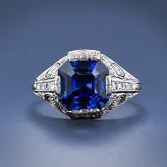 An original Tiffany & Company sapphire ring from the early 20th century. This amazing and exceptional platinum ring is set with an 8.00 carat square emerald-cut sapphire of an extraordinary vibrant blue and is accompanied by a GIA report stating Sri Lanka (Ceylon) origin and no indications of heat treatment. The sapphire is embraced in a hand crafted mounting dotted with both French cut and round cut diamonds punctuated with delicate scroll pierce and milgrain work.