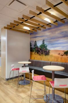 Break room at Golder Associates - office interior design by SSDG Interiors Inc. - wood flooring, banquette, high tables, wood slat feature, wall graphic, modern office design