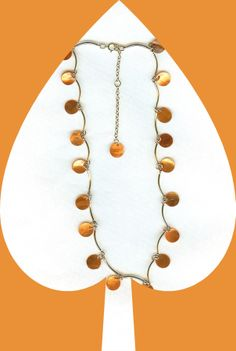 EDE Gold Mother of Pearl Disk Necklace http://www.edenterprises.biz/Mother%20of%20Pearl%20Disk%20Gold%20Red%20Dangle%20Necklace.jpg