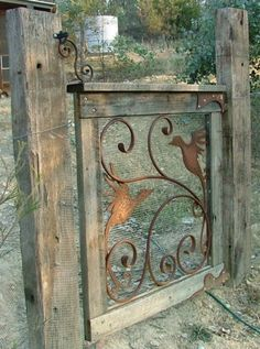 Iron ornamentation from an old screen door, used with rabbit screen for a great garden gate...