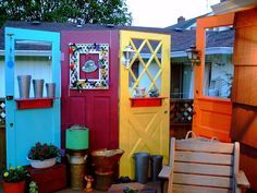 "Brightly painted old doors to create ""rooms"" in the yard or garden. Reminds me of India."