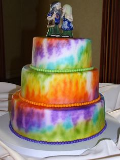 A tie dye wedding cake for this whimsical wedding. Cakes by Graham     More Than Just Icing On The Cake