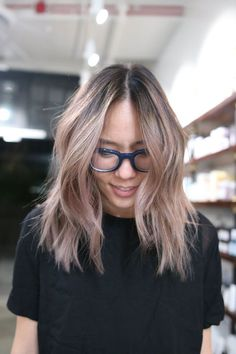 "Let's start off softly — super softly — with L.A. colorist Cherin Choi's take on the trend in its subtlest form. She calls this hue ""dusty pink"" and suggests asking your colorist to tint ""low-maintenance highlights for an easy grow out."" Already blond? Ask for just a whisper of gray-ish pink, then keep it looking fresh with a pink-based conditioner. (Try this one from Urban Outfitters.)Pink and gray tones fade fast, so getting an in-salon toner to maintain the color will be necessary more…"