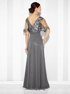 Cameron Blake - 117622 - Chiffon A-line gown with illusion bateau neckline and sequin lace illusion elbow-length flutter sleeves, sequin lace accented V-bodice, finely ruched waistband, V-back, short illusion bell sleeves, center gathered skirt.Sizes: 4 – 20, 16W – 26WColors: Smoke, Navy Blue, Dark Plum