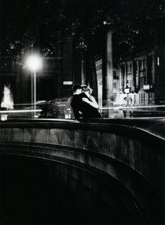 Loving couple on bridge. London, 50s.