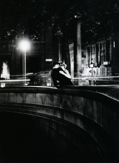 Loving couple on bridge. London, 50s.