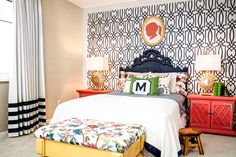 Darling Bedroom: Coral silhouette | navy & white geometric wallpaper | coral night stands | navy headboard | single monogram pillow | white bedding | floral bench | drapes with navy stripes