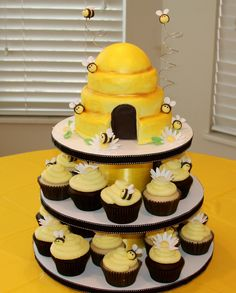 Bumble bee cupcake tower - Home-made cc tower.  Hive is styrofoam covered with fondant.  Made for my baby's 1st b-day.