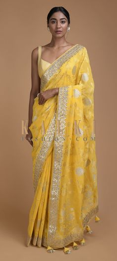 Blonde yellow banarasi saree in georgette with weaved floral jaal. Further enhanced with gotta patches and zari embroidered border in leaf pattern. Lehenga Style Saree, Sari, Saree Blouse Patterns, Saree Blouse Designs, Pakistani Bridal Wear, Pakistani Dresses, Celebrity Fashion Outfits, Celebrities Fashion, Celebrity Style