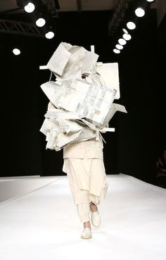 """Craig Green for MAN - Mugatu's designs from """"Zoolander"""" are becoming real. This all-white construction of trash couture has """"Derelicte"""" written all over it."""