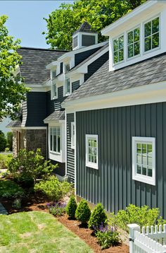 Small Family Home with Inspiring Interiors- see variations of exterior siding: shingle, clapboard, board & batten