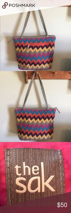 THE SAK Shoulder Bag In excellent pre-loved condition! Chevron pattern with teal, orange, purple, yellow, gray and pink. Handles and zippers are in excellent condition. There are two slip pockets and one zippered pocket interiorly. There is one small stain on the interior lining of the bag (please see pic).  Otherwise in excellent condition! From a smoke free home! The Sak Bags Shoulder Bags