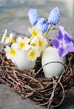 Use egg shells, spring flowers, and woven twigs to create an Easter centerpiece. From the book 'The Crafted Garden' by Louis Curley