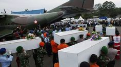Caskets containing the remains of AirAsia QZ8501 passengers recovered from the sea are carried to a ... - Reuters