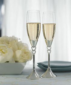 "Bliss Wedding Supplies - ""Double Heart"" Champagne Flutes, $38.98 (http://www.blissweddingsupplies.com/double-heart-champagne-flutes/)"