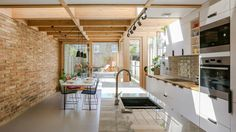 The client wanted to extend their terraced house to create a more usable kitchen and dining area with a better connection to the rear garden. Nimtim proposed an addition formed with a series… A Frame Cabin, A Frame House, Industrial Kitchen Design, Kitchen Interior, Dining Area, Kitchen Dining, Küchen Design, House Design, Glass Extension