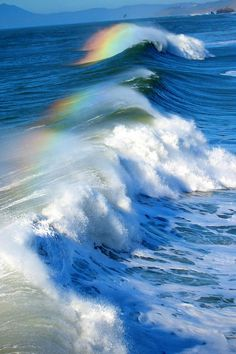 This is so cool! Where rainbows form on the water of the waves as they come in.