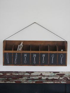 Free up your cupboard drawers by storing your eating utensils, candles, and napkins in a wall-mounted divided shelf. For versatility, label each cubby with a square of chalkboard paint. Hang the shelf in an easy to reach, well traveled portion of your kitchen.... I love this idea but I'm put of wall space! Ha!