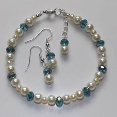 Beautiful crystal and pearl braclet  earing set blue and ivory colour handmade