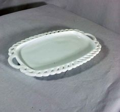milk glass open butter dish (also tray for sugar/creamer).  I need to research which it is made for, I've seen it as both.