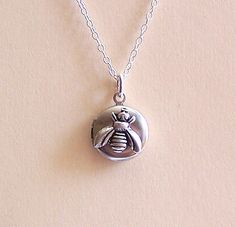 Hey, I found this really awesome Etsy listing at https://www.etsy.com/uk/listing/223960460/sterling-silver-bee-locket-necklace