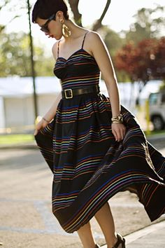 brights stripes on a bed of black, long dress that requires no bra. perfect. if it had pockets.