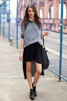 Street fashion: short in front long in back skirt and a cute sweater. Interesting!!!(: