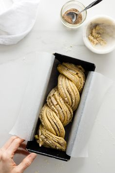 White Chocolate and Cardamom Babka: Sweet, airy dough filled with twists of cardamom flecked white chocolate. Simple and delicious. #babka #bread #recipe #israeli #baking