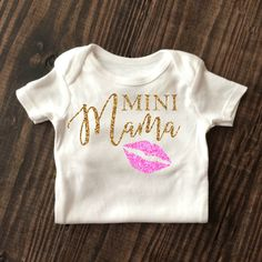 Mini Mama Baby Girl Sparkle Onesie in Glitter Gold and Glitter Pink. Browse our entire collection of sparkle wear at www.shopcassidyscloset.com
