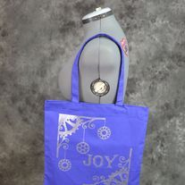 "Hand painted blueberry bag with a Steampunk Christmas ""Joy"" design on it. Design is painted in silver on one side only. Perfect for conventions, trips to the comic shop, as a reusable shopping bag or as a purse.  Blueberry (Blueish purple) 100% cotton canvas promo bag (thinner than reg. canvas ..."