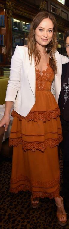Who made Olivia Wilde's orange lace dress, white blazer, and sandals?