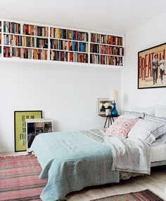 This raised bookcase is something we can support. Not only does it create a place for books, it frees up ground space for things like an alternative gallery wall.  Source: Domino
