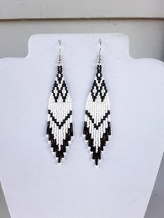 These Native Beaded White and Black Earrings are custom made it Silver lined Silver Twisted Bugle Beads on them. They are about 4 in. long with silver wires on them, can be changed to post or clips. It you have any Questions just ask. Seed Bead Jewelry, Bead Jewellery, Seed Bead Earrings, Hoop Earrings, Fringe Earrings, Jewelry Findings, Wire Jewelry, Jewlery, Jewelry Bracelets