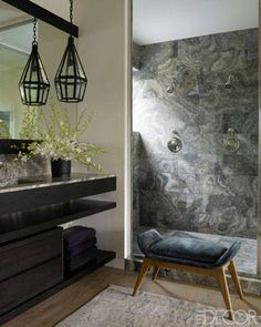 No glass walls in shower-- eliminates problem on hard-to-remove mineral deposits accumulating on the glass!    Courteney Cox's Private Retreat: Master bath's shower is sheathed in onyx tiles; Speakman showerheads; waterworks fittings.